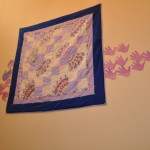 One of many beautiful, hand-made quilts donated by Eastside Quilters for our shelter.