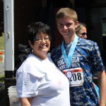 Martha Lasher-Warner congratulates a runner in The Run for Help