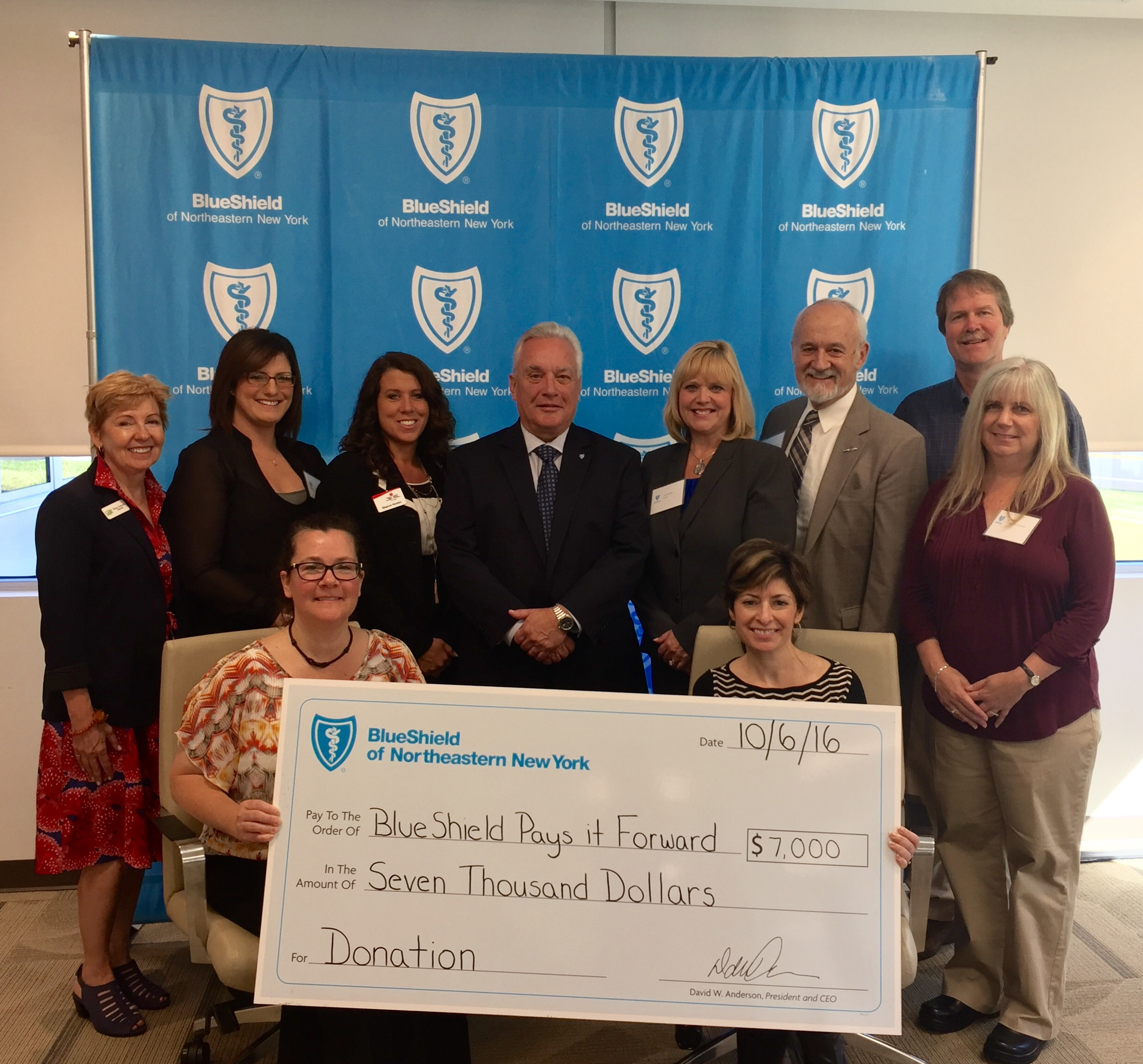 blue shield of northeastern ny writes big check, Powerpoint templates