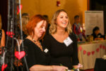 Maggie Watson, left, shares a laugh with Kelley from Collar City Sweets.