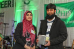 Uzma Popal and Saad Khan with the award for the Muslim Soup Kitchen Project.